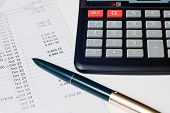 Calculator Pen And Bank Statement
