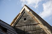 historic wooden rooftop with sun symbol