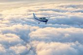 Small Single-engine Airplane Flying In Stunning Mesmerizing Sunset Sky poster