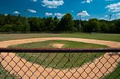 stock photo of little-league  - Little league baseball field over looking home plate from the announcer - JPG