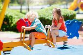Kids On Playground. Children Play In Summer Park. poster