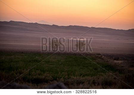 poster of Sunset Landscape View Of Silhouette Mountains And Lonely Trees In Azerbaijan. Sheki