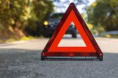 Red Triangle, Red Emergency Stop Sign, Red Emergency Symbol And Black Car Stop And Park On Road. poster