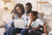 Online Shopping. Happy Black Mother, Father And Daughter Using Laptop And Credit Card, Buying Goods  poster