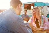 Group Of Friends Eating Takeaway Food From Truck At  Outdoor Music Festival poster