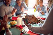 Family and friends dining at home celebrating christmas eve with traditional food and decoration, sh poster