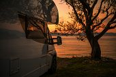 Recreational Vehicle Camper Van Rv Park Site Scenic Sea Front Sunset. Motorhome Road Trip. poster