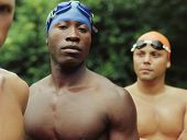 Multi-ethnic male swimmers outdoors