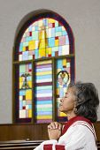 foto of piety  - African American female Reverend praying - JPG