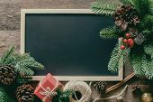 Holiday Christmas Wallpaper With Blackboard Or Chalkboard For Copy Space. Christmas Card Background  poster