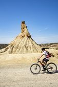 Man Rides On Wonderful Mountain Biking Trails In Bardenas Reales. Natural Park. Biosphere Reserve By poster