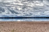 Beautiful Cloudscape Over The Sea From Sandy Beach. Baltic Sea Hdr poster