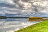 Beautiful Cloudscape Over The Sea From Green Grass. Baltic Sea Hdr poster