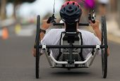Disabled Athlete In A Sport Wheelchair During Marathon poster