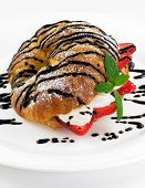Croissant Stuffed With Cream And Fresh Strawberry