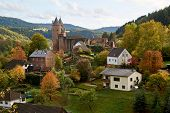 German Bertrada Castle In The Eifel With Shining Autumn Leaves poster