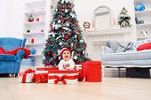 Charming Toddler Girl Holds White Christmas Gift Box With Red Ribbon. Funny Cute Baby Weared In Fest poster