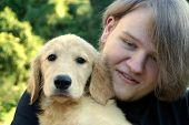 Teen Boy And Golden Puppy 2