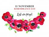Remembrance Day Poppy Wreath. Red Flowers And Title 11 November Lest We Forget. Hand Drawn Watercolo poster