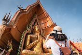 Tourist Woman Having Fun While Sightseeing In The Temple, Asian Woman Relaxing And Enjoyment While P poster