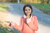 Music Of Autumn Leaves. Happy Little Girl Wear Headphones On Autumn Landscape. Cute Child Smile With poster