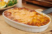 picture of enchiladas  - A chicken enchillada casserole topped with cheddar cheese - JPG