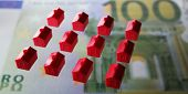 stock photo of statistician  - Little houses for Financing Building or insurances - JPG