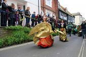 HASTINGS, ENGLAND - MAY 7: Dancers perform during a parade at the Jack In The Green festival on May 7, 2012 in Hastings, East Sussex. The annual event marks the May Day public holiday in Britain.