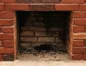 Backdrop of a brick fireplace wall
