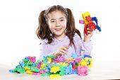 little girl enjoys playing