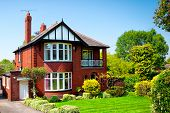 stock photo of british culture  - Typical English house in spring garden - JPG