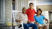 African American Family Relaxes On Porch 3