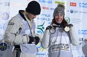 BUKOVEL, UKRAINE - FEBRUARY 23: Winners in aerial skiing Emily Cook, USA (right) and David Morris, A