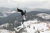BUKOVEL, UKRAINE - FEBRUARY 23: Jonathon Lillis, USA performs aerial skiing during Freestyle Ski World Cup in Bukovel, Ukraine on February 23, 2013.