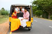 Asian Couple Traveling In A Phut-phut poster