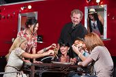 image of patron  - Smiling outdoor mobile restaurant chef with happy patrons - JPG