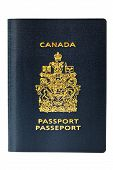 stock photo of passport cover  - New freshly issued Canadian passport waiting for its maiden voyage - JPG