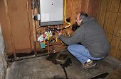 Man Fixing Furnace