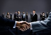 stock photo of handshake  - handshake isolated on business background - JPG