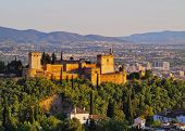 stock photo of cultural artifacts  - Cityscape of Granada with a view of famous Alhambra - a palace and fortress complex Andalusia Spain