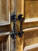 Close-up Of Weathered Wooden Double Doors And Iron Handles poster