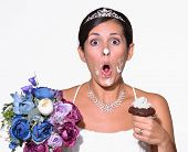 Funny bride eating cake.