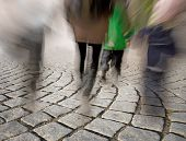 People Walking On Cobble Stones