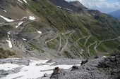 stock photo of italian alps  - Serpentine road in the italian Alps which leads to Stelvio Pass - JPG
