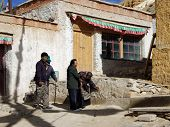 Children Are Elderly Parents In The Temple. Shigatse, China, Tibet, September 2011