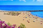 MASPALOMAS, SPAIN - OCTOBER 9: Playa del Ingles beach on October 9, 2013 in Maspalomas, Gran Canaria