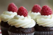 image of cupcakes  - Chocolate cupcakes decorated with fresh cream and raspberries - JPG