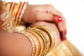 stock photo of indian sari  - hand detail of indian bride with decorative bangle and gold ring - JPG