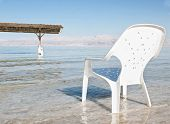 Plastic Easy Chair In The Shallow Waters Of The World Famous Dead Sea, Israel.