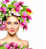 Spring Woman. Beauty Summer model girl with colorful Flowers Hair Style. Beautiful Lady with Bloomin
